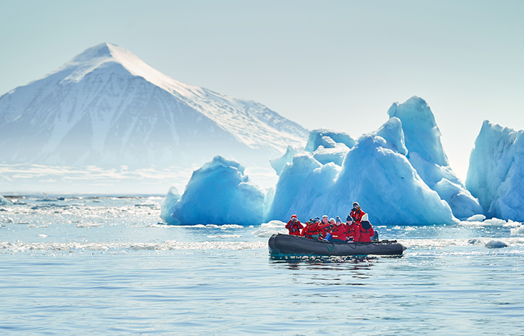 Guests in RIB boat navigating through icebergs