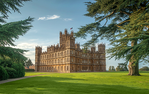 Highclere Castle with trees in foreground