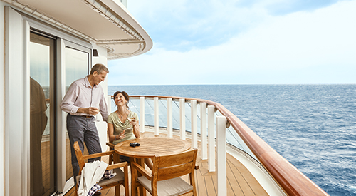 Couple on veranda of Explorer Suite stateroom