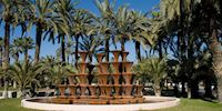 Elche Fountain with palm trees