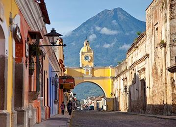 Antigua, Guatemala with a volcano in the background