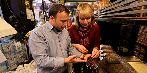 Two people looking at coffee beans