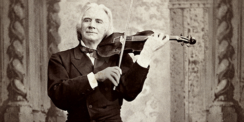 Ole Bull playing violin - a black and white photo.