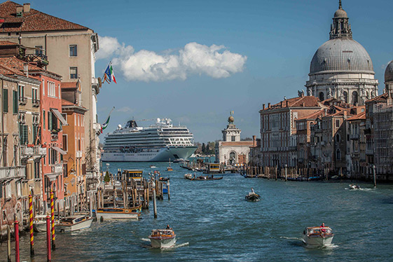 Viking Star towering through the Venice canals.